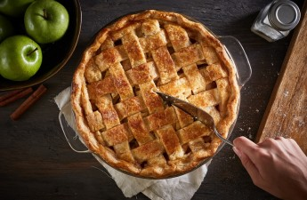 Series of homemade whole and sliced apple pie images on a dark wood surface with ingredients and utensils.